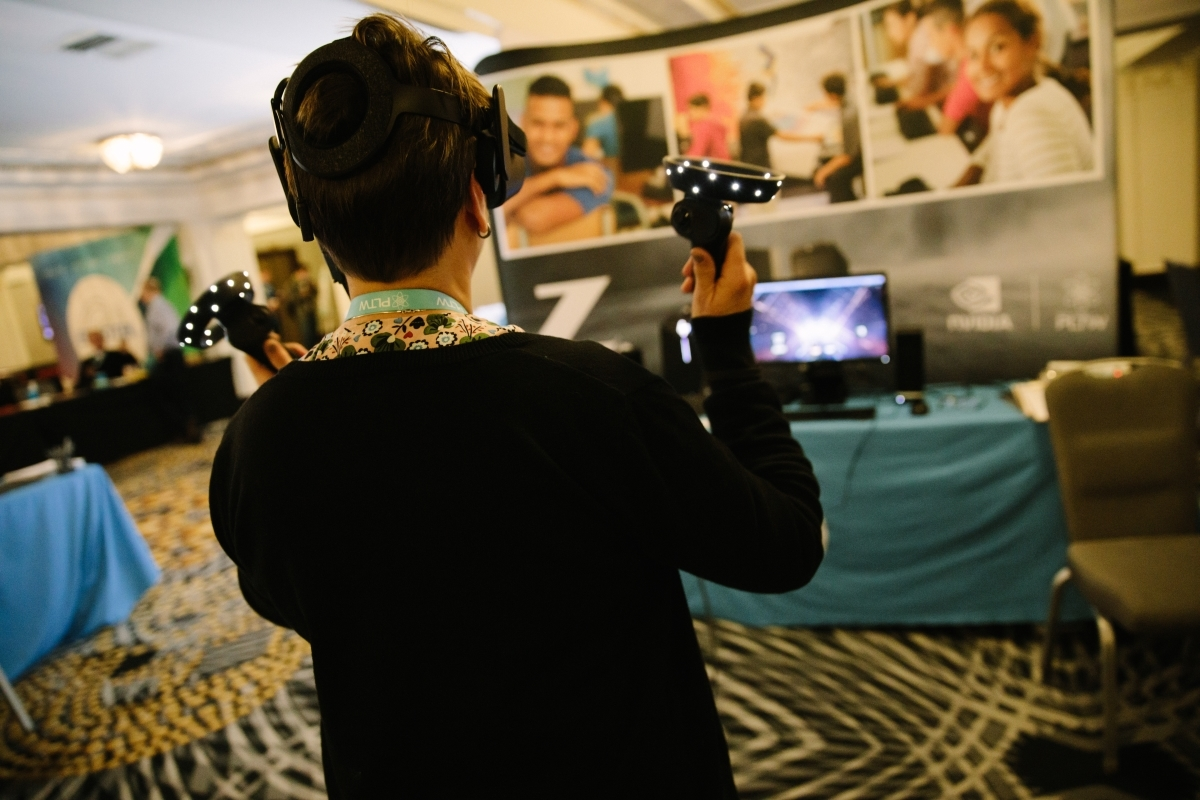 PLTW Summit Kansas City Participant trying out virtual reality game