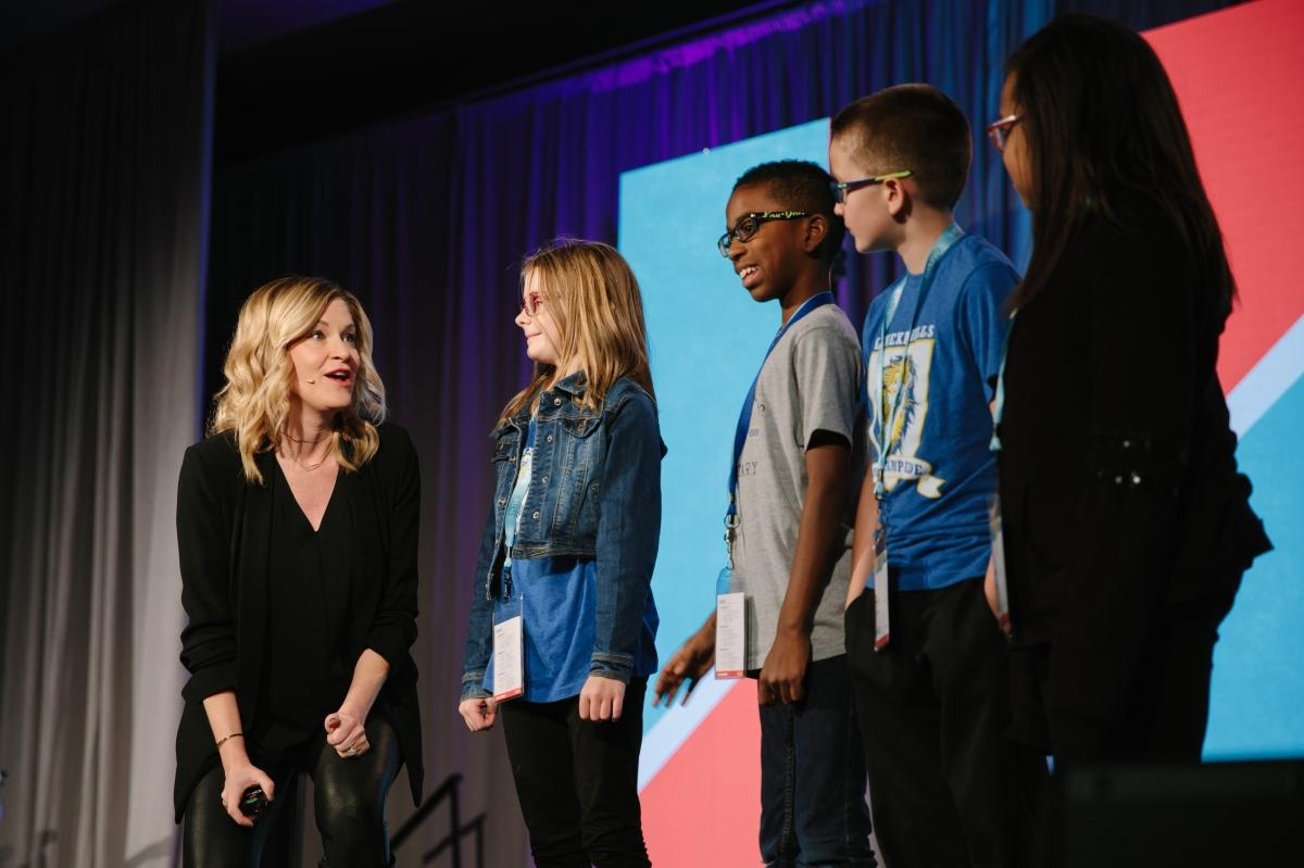 PLTW Summit host Judi Holler talking to students